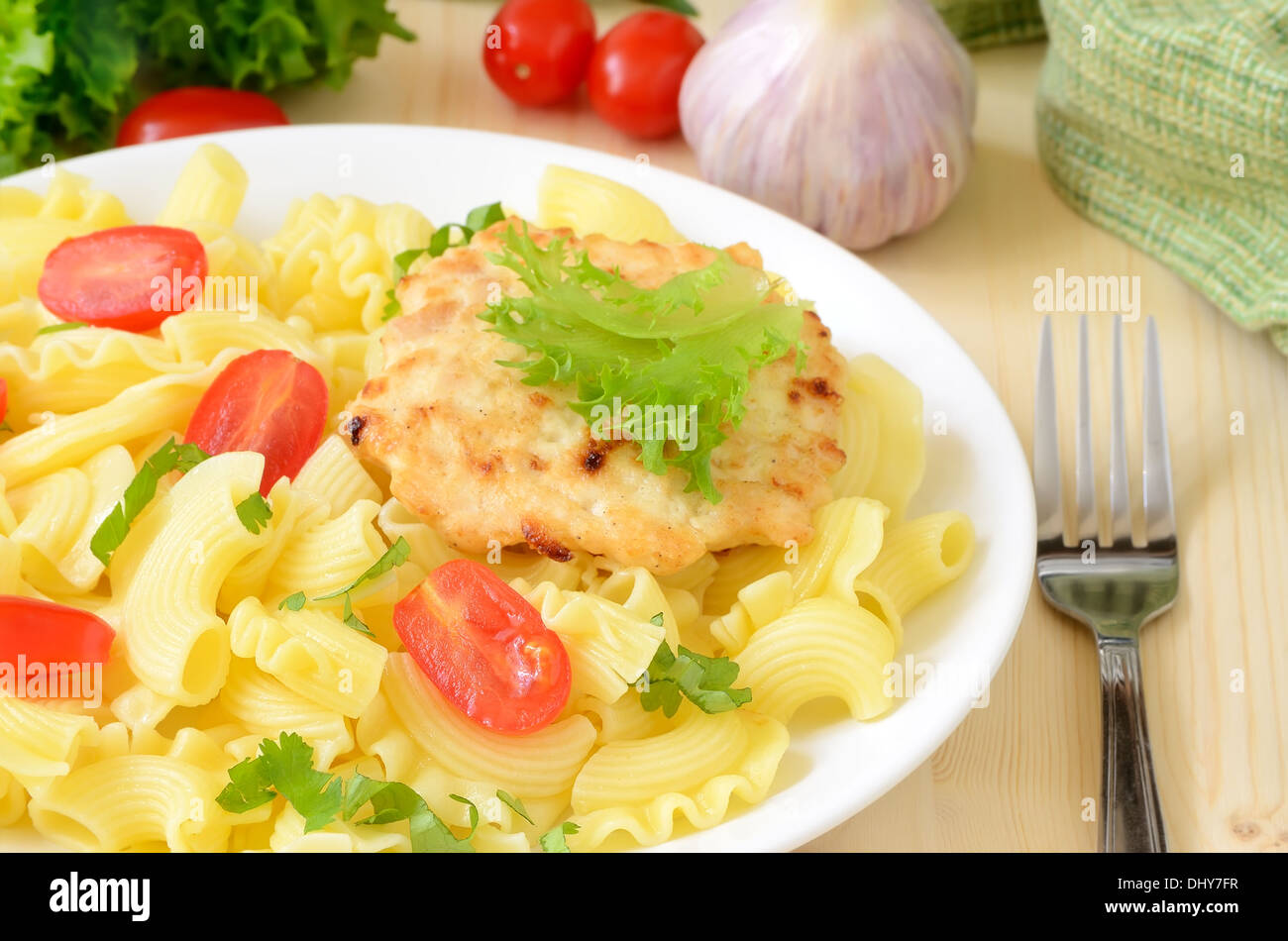 Pasta with tomatoes and chicken cutlet - Stock Image