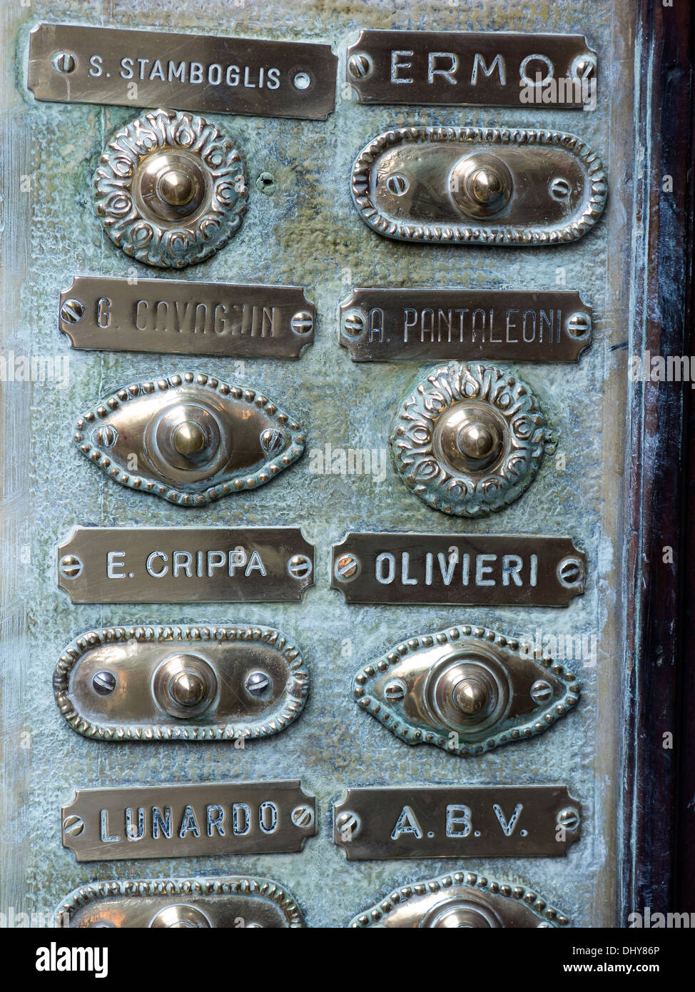 Old ornate decorative brass bell pushes and Italian nameplates, Venice, Italy. - Stock Image