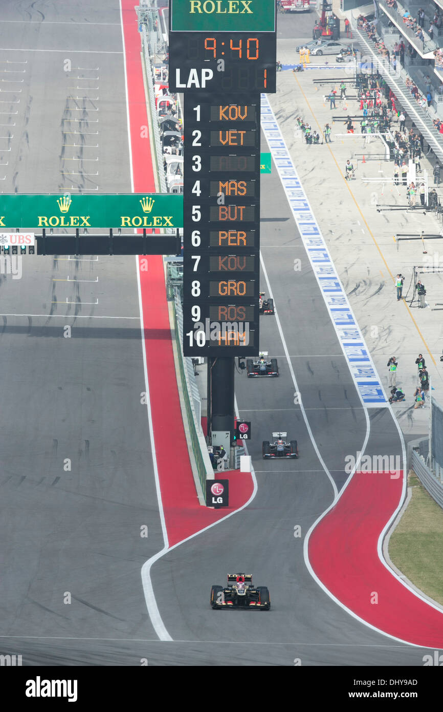 Cars head to turn one during practice session for the Formula 1 United States Grand Prix near Austin Texas - Stock Image