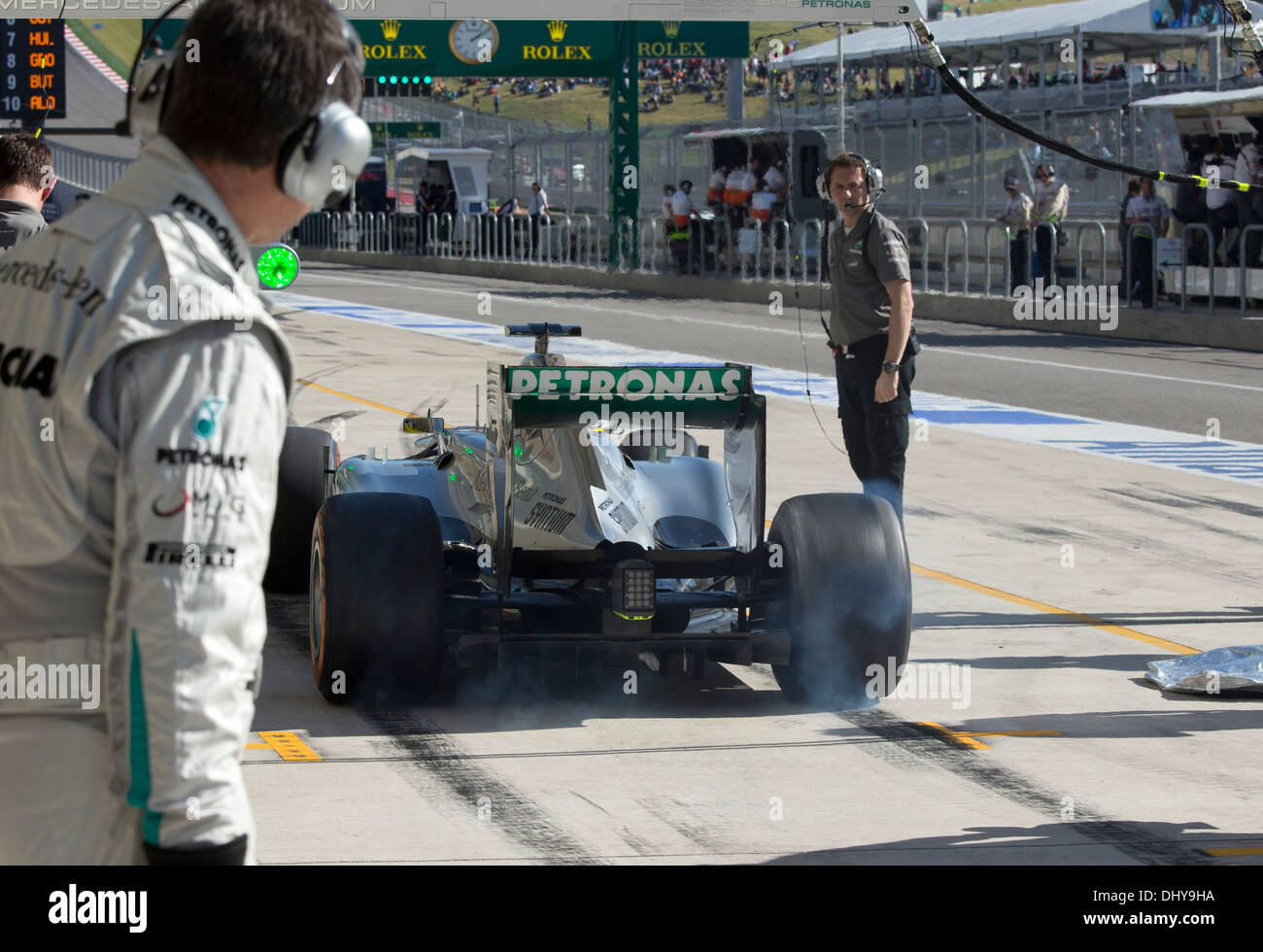 e28c5e674f79b Driver Lewis Hamilton of Mercedes AMG Petronas burns rubber leaving the  pits at practice session for