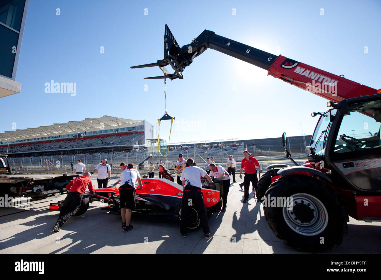 Disabled Formula 1 car is lifted from the pit area during a practice session for the United States Grand Prix near Austin Texas - Stock Image