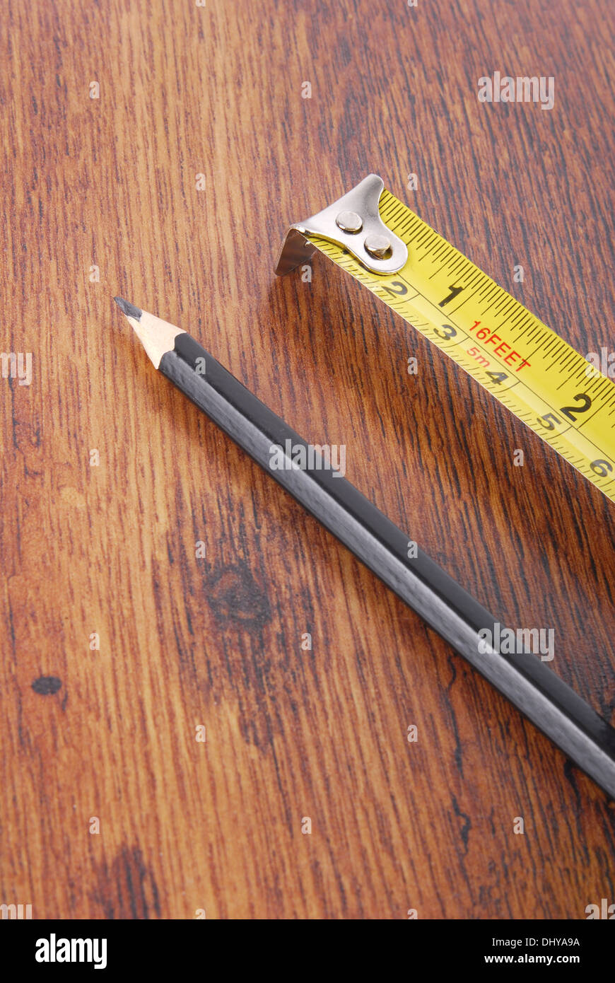 laminate and tape measure and pencil - Stock Image