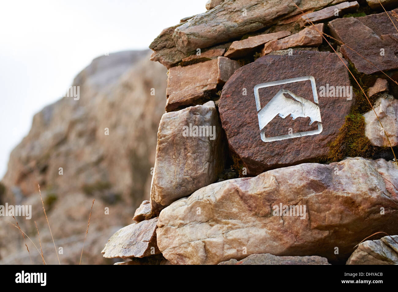 A mountain path marker, Sign in the Scottish Highlands, UK. - Stock Image