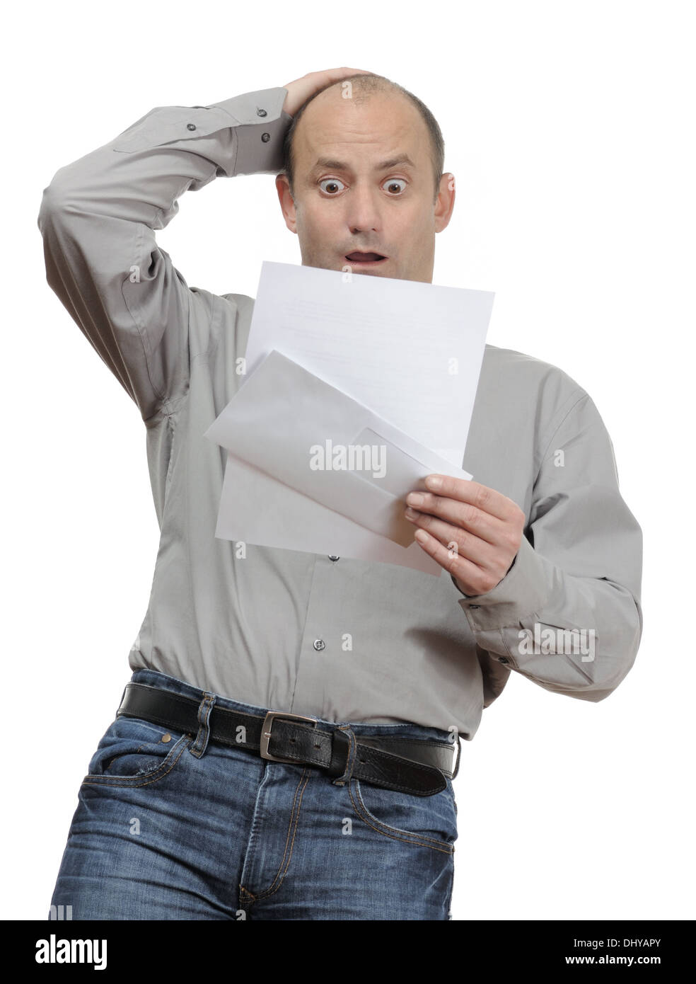 Shocked man reading a bad announcement letter - Stock Image