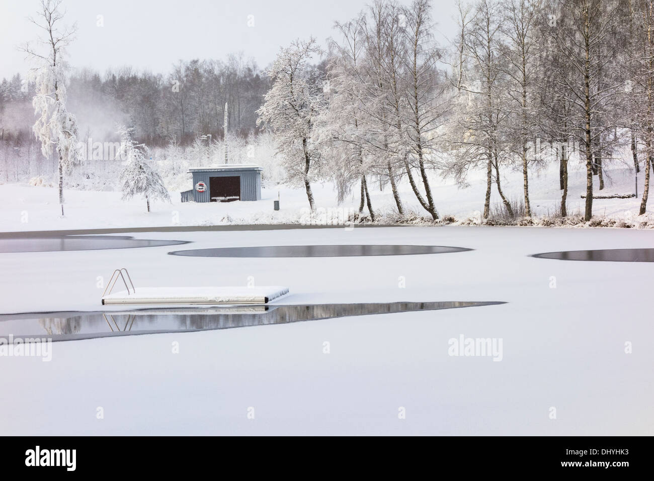 Bathing place with bridge in winter with snow - Stock Image