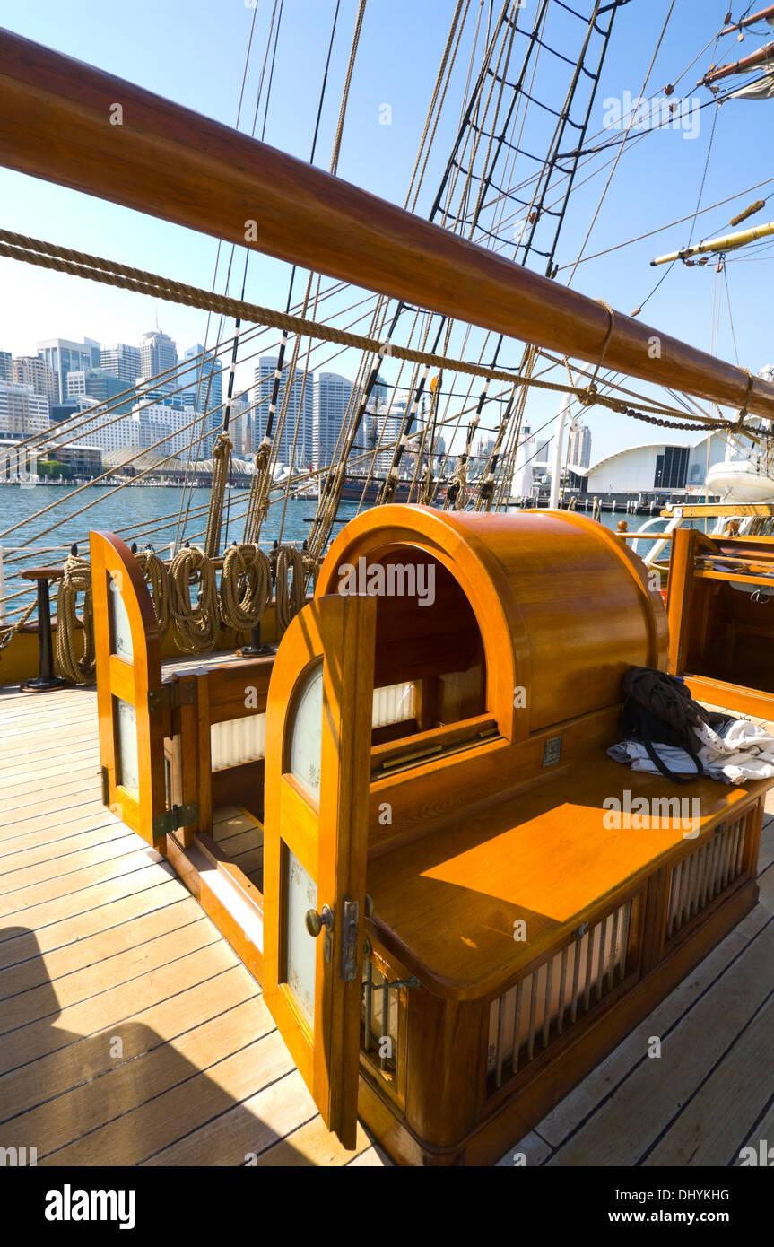 Deck of the James Craig Tall Ship, with Sydney skyline, Australia - Stock Image