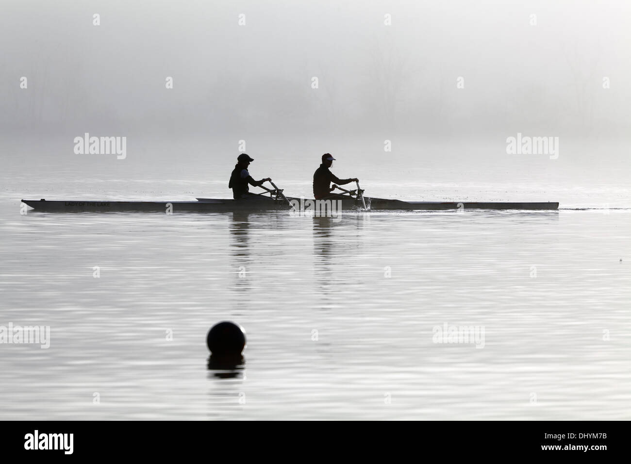 Rowers training in early morning mist, Scotland, UK - Stock Image