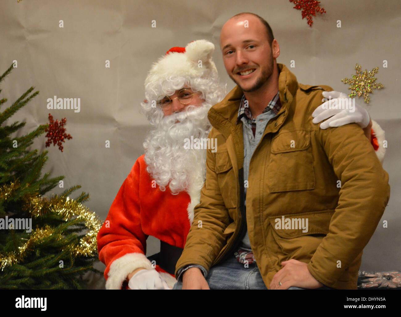Grown man on Santas lap! - Stock Image