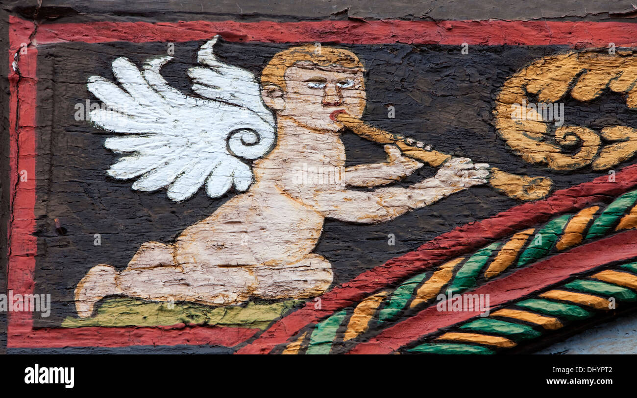 angel with flute, Ornate Fachwerk-style, Decorations on a half-timbered house, Einbeck, Lower Saxony, Germany, Europe - Stock Image