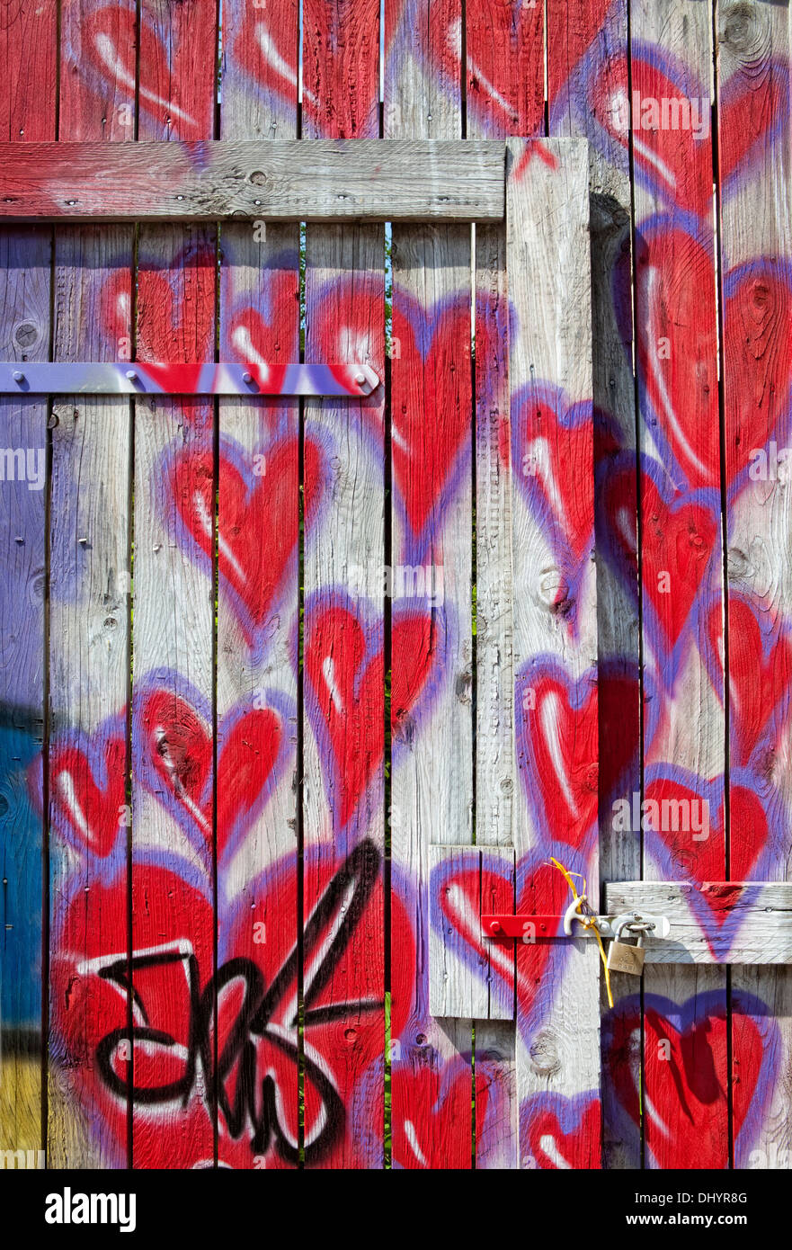 Red hearts painted on a fence, graffiti, Germany, Europe - Stock Image