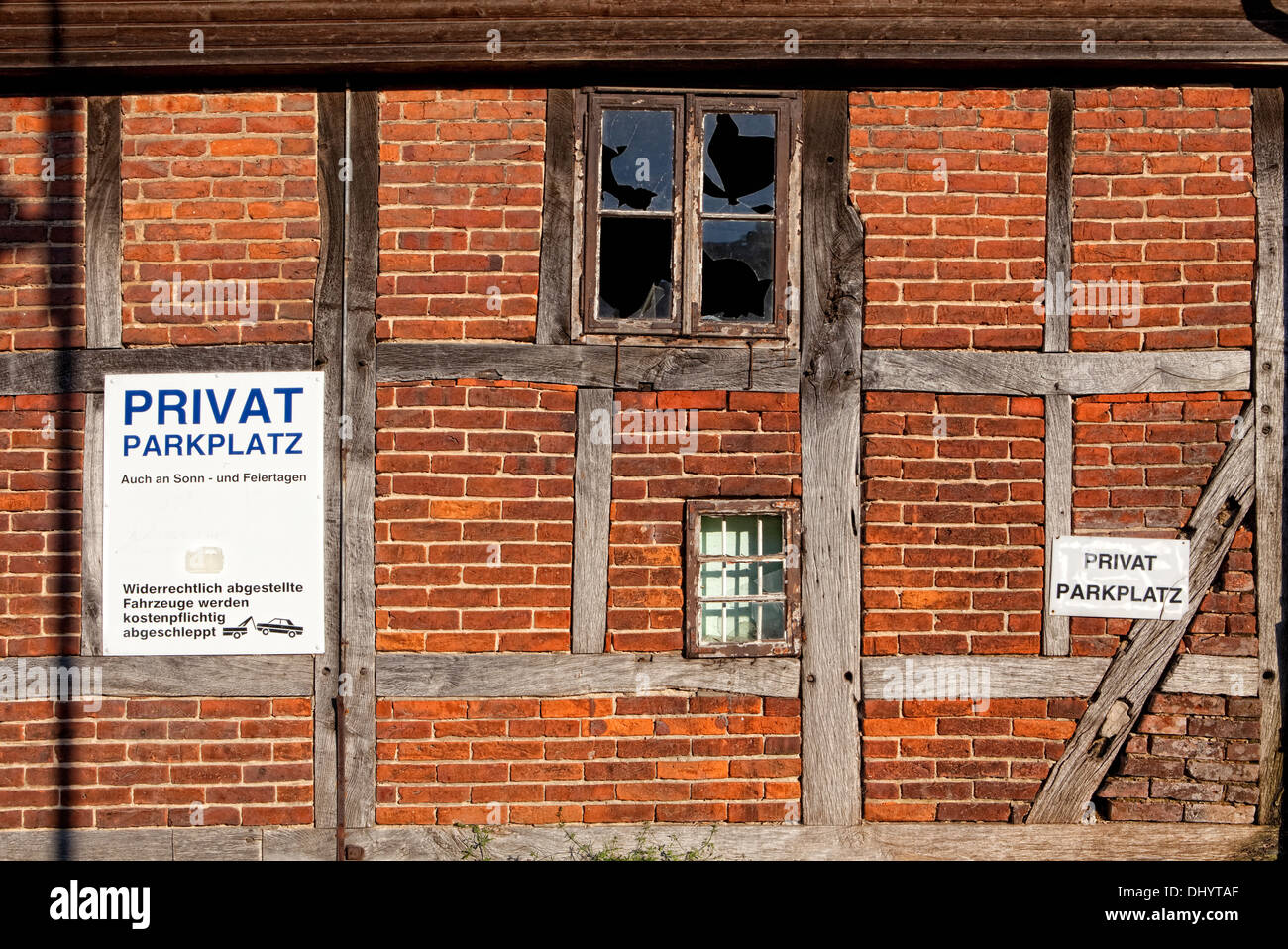 Old wall with no parking signs, private car park, Germany, Europe - Stock Image