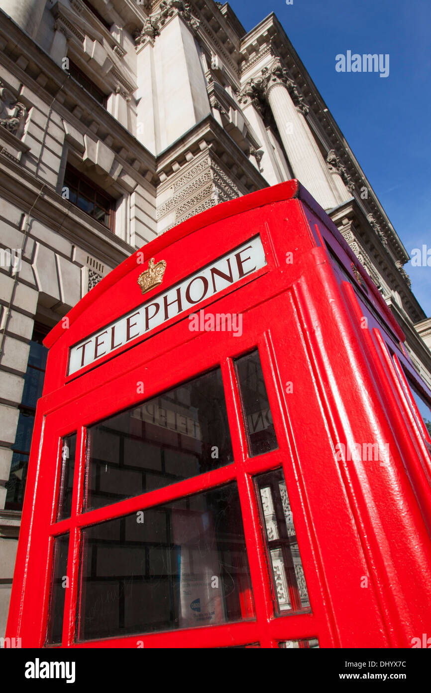 A traditional red telephone box in Westminster, London. - Stock Image
