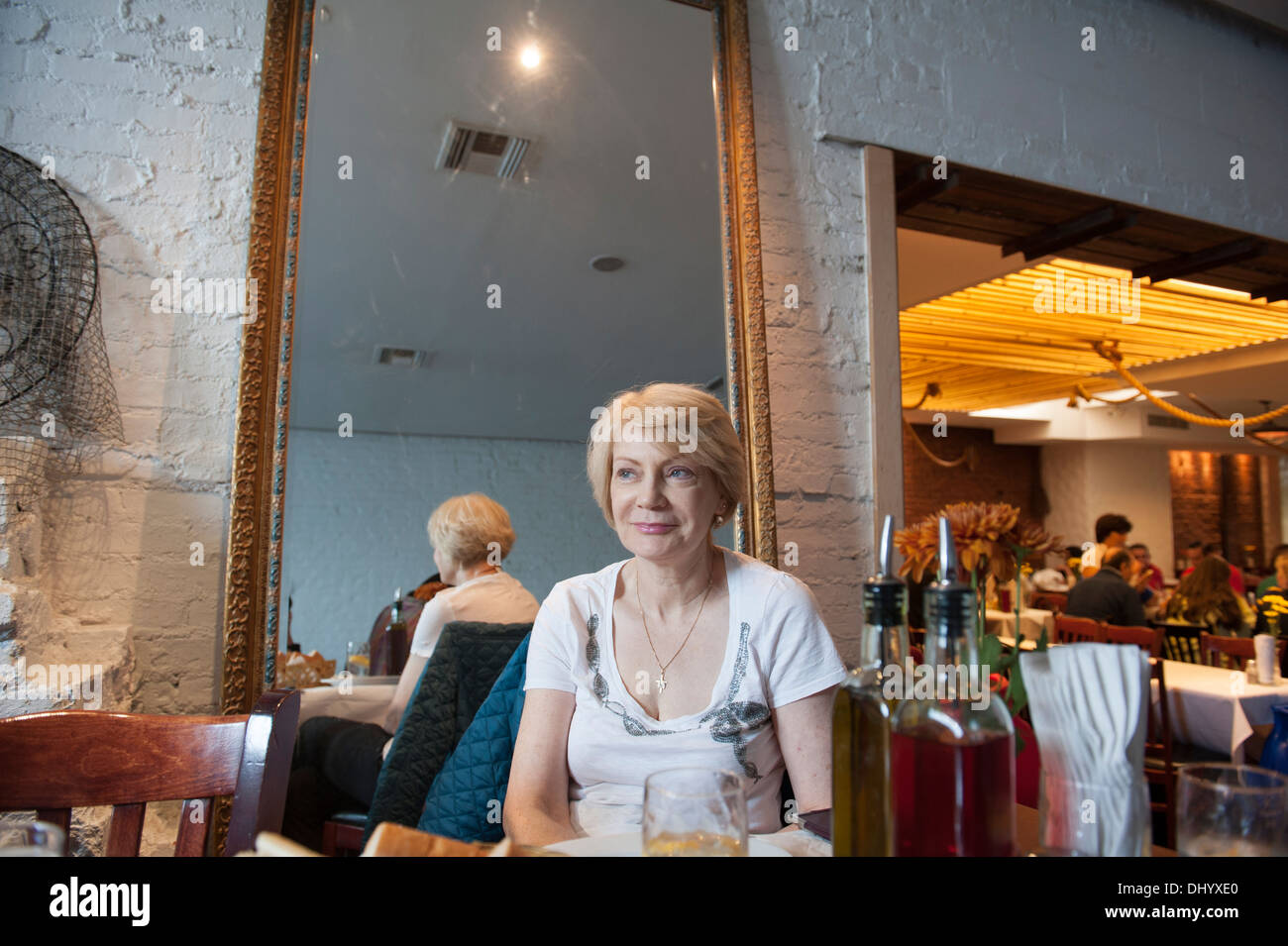 A Middle Aged Woman In A Greek Restaurant In Astoria Queens