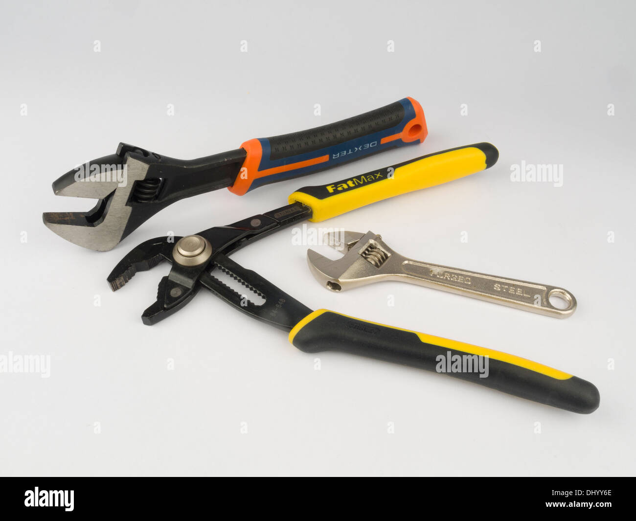 Adjustable wrenches (spanners) and pipe wrench pliers isolated on white background - Stock Image