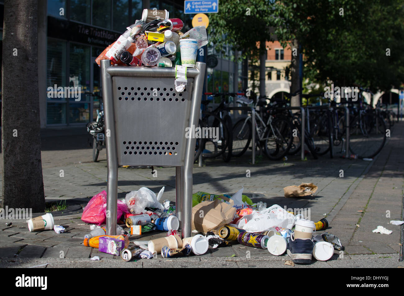 Rubbish bin over flowing with rubbish Stock Photo