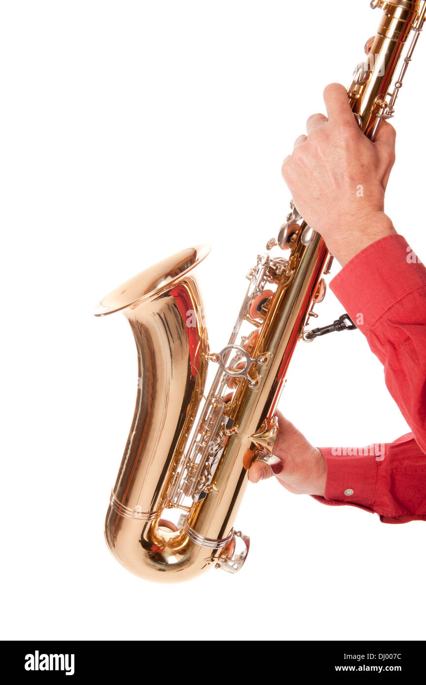 Male entertainer playing a brass tenor saxophone with silver valves and pearl buttons in close up - Stock Image