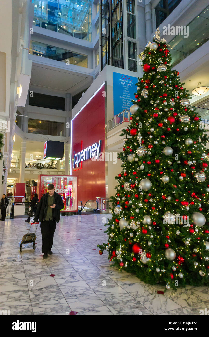 the lobby of the manhattan mall where jcpenney is located is seen decorated for christmas