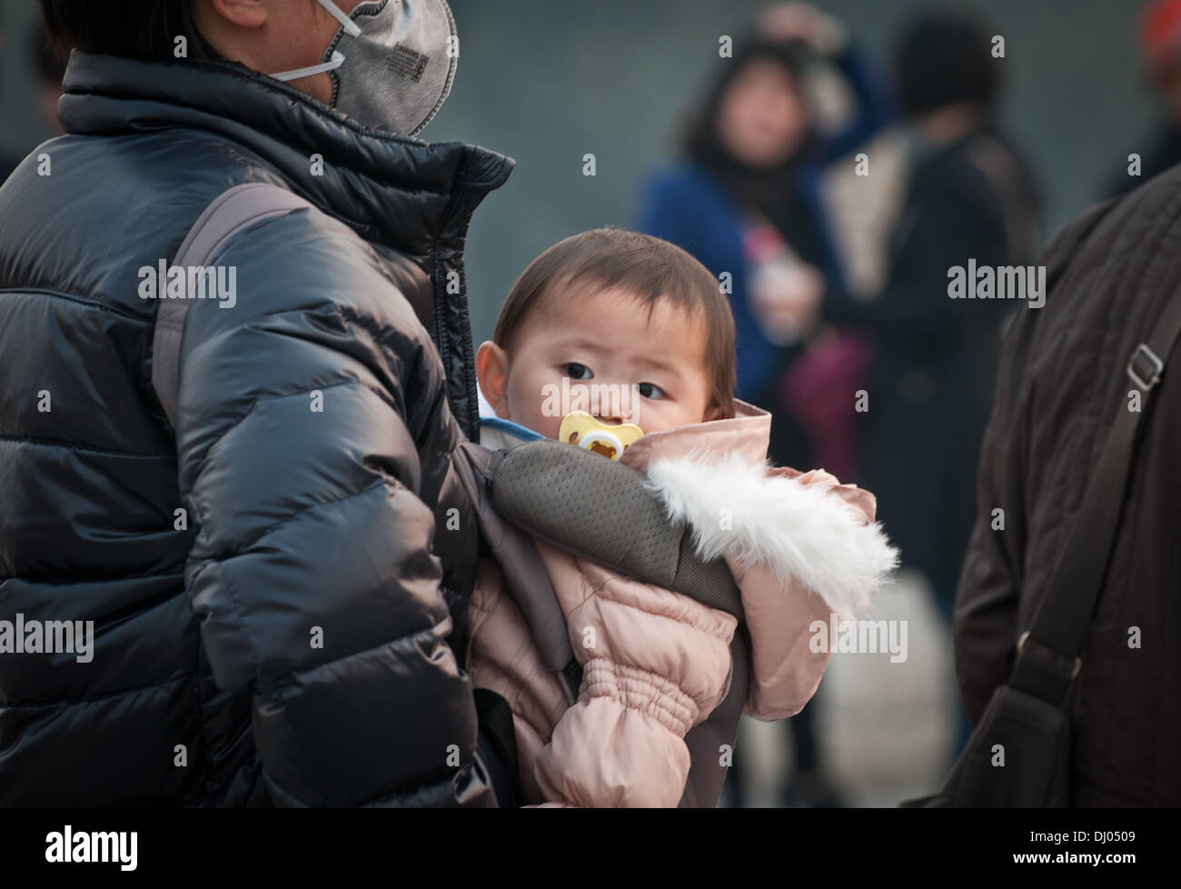 Man carrying his baby in carriers, Temple of Heaven, Beijing, China - Stock Image