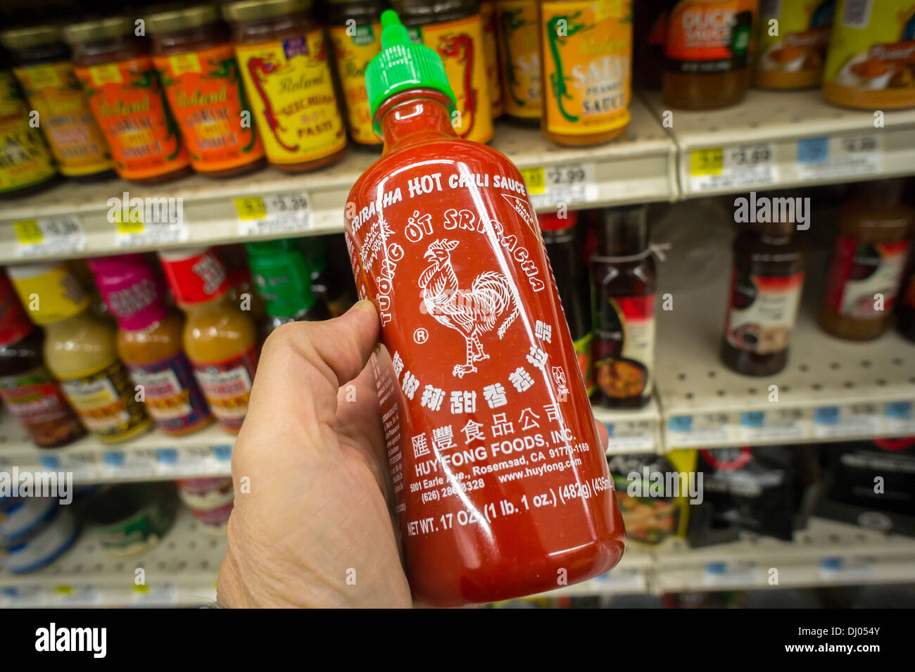 A bottle of Sriracha hot sauce manufactured by Huy Fong Foods is seen in the asian food section of a supermarket in New York - Stock Image