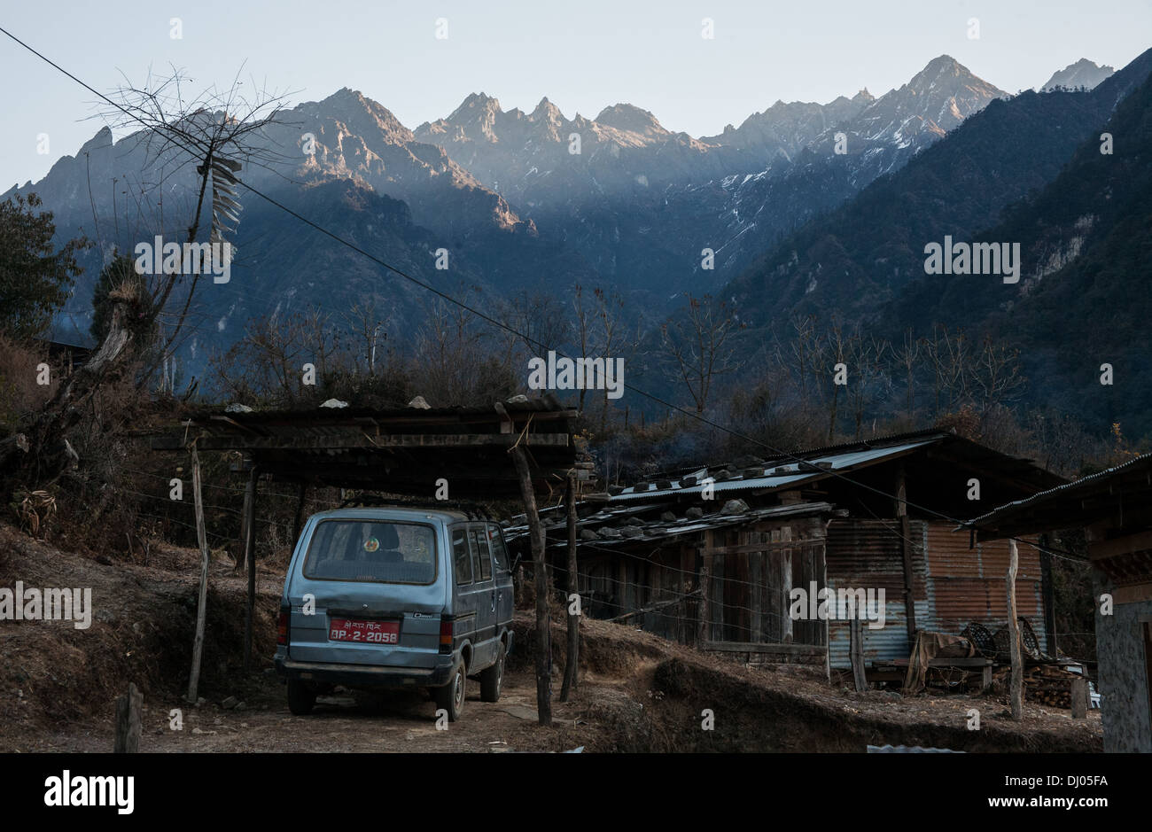A battered car in a remote part of Western Bhutan - Stock Image
