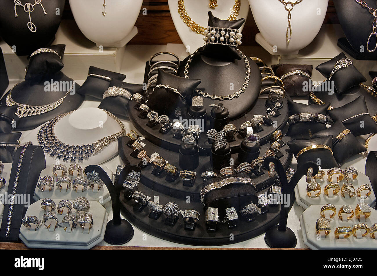 Jewelry displayed in a store window in Antwerp's diamond district Stock Photo