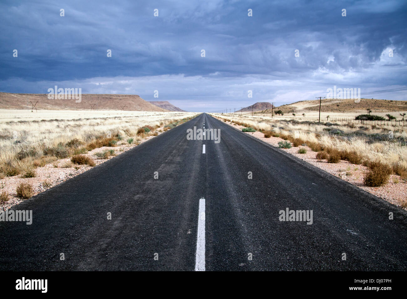 Long deserted Highway - Stock Image