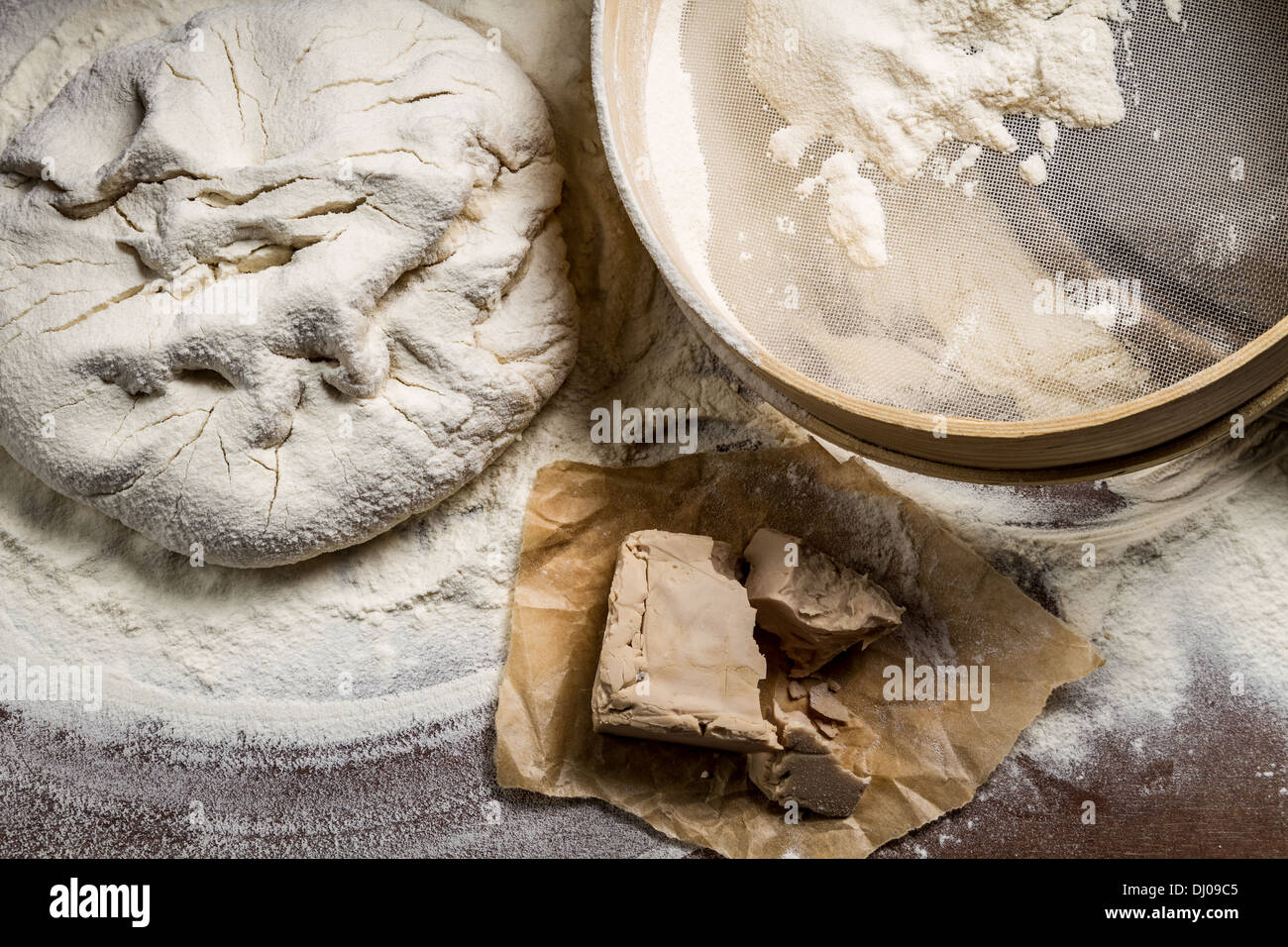 Homemade pizza dough made from yeast and flour - Stock Image