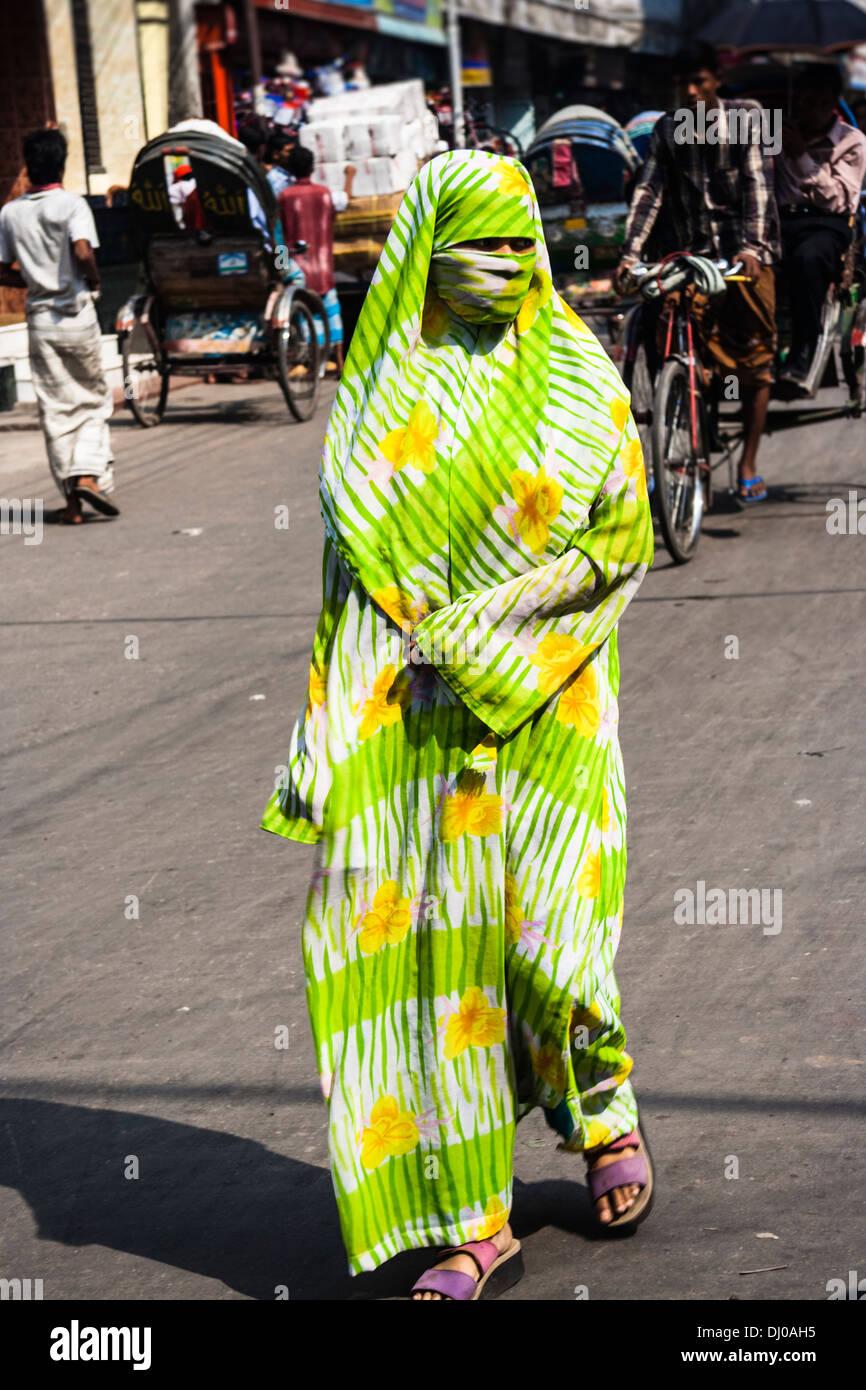 Veiled Muslim woman in colorful full body cloak. Old Dhaka, Bangladesh Stock Photo