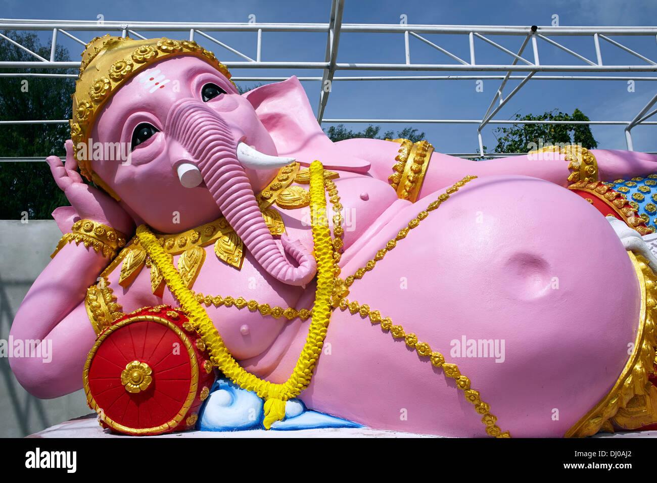 Reclining pink Ganesha deity statue Thailand S. E. Asia - Stock Image
