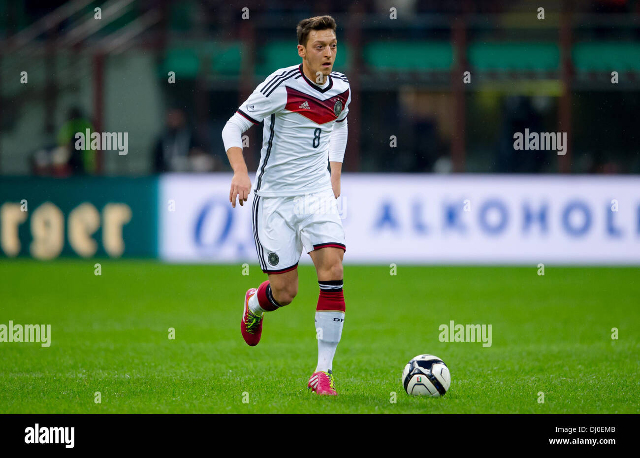 Milan, Italy. 15th Nov, 2013. Germany's Mesut Oezil plays the ball during the friendly soccer match between Italy Stock Photo