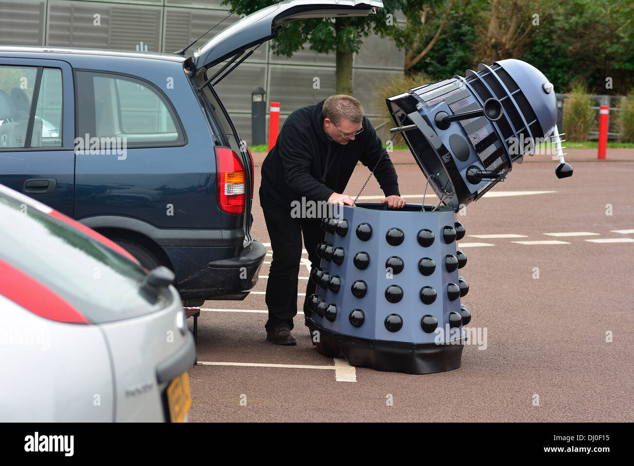 Ray Hyde from Barnsley assembles one of the 20 Daleks displayed at the 'Science of the Timelords' event are assembled at The National Space Centre at Leicester. - Stock Image