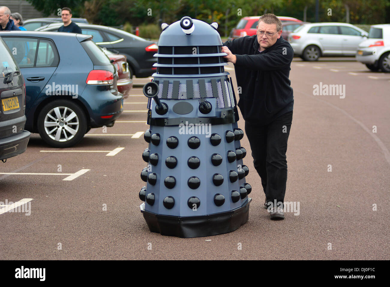 Ray Hyde from Barnsley wheels in one of the 20 Daleks displayed at the 'Science of the Timelords' event are assembled at The National Space Centre at Leicester - Stock Image