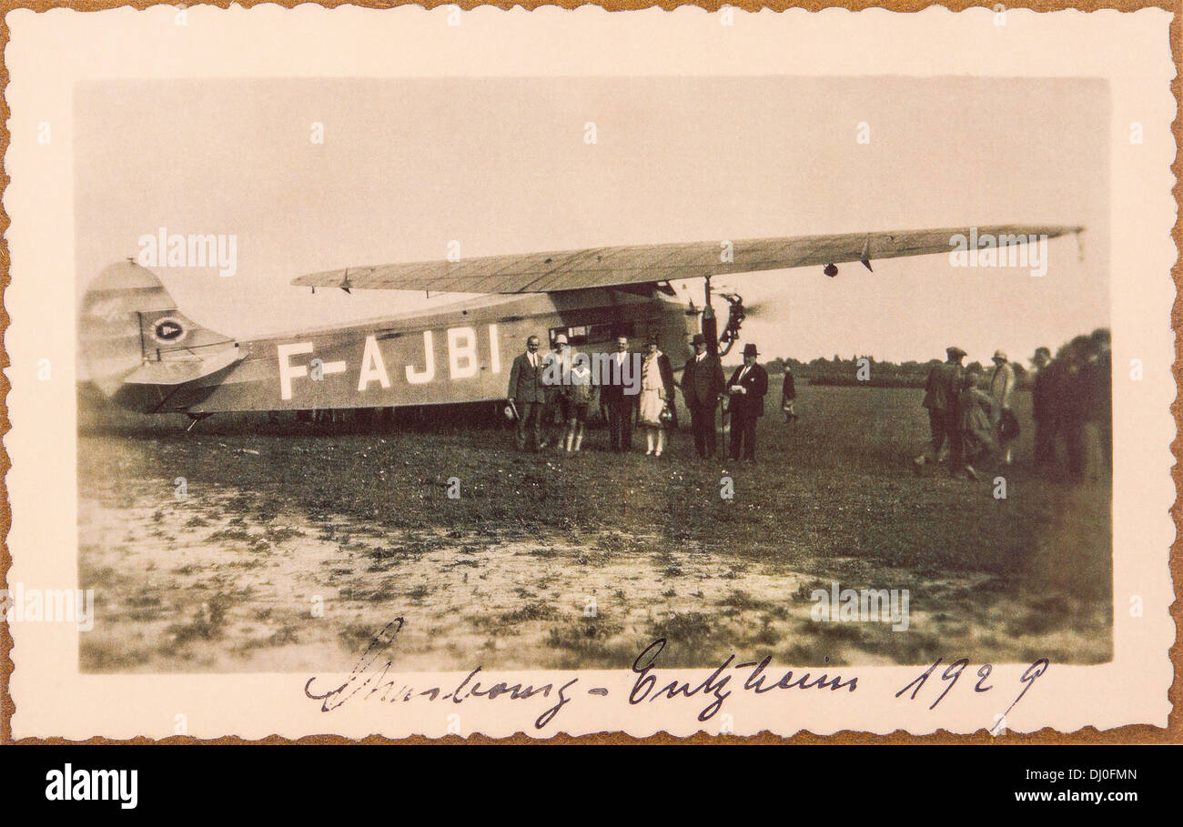 1929 vintage picture of Strasbourg-Entzheim airport with Fokker F.VIIa retro airplane and passengers Strasbourg Alsace France Europe - Stock Image
