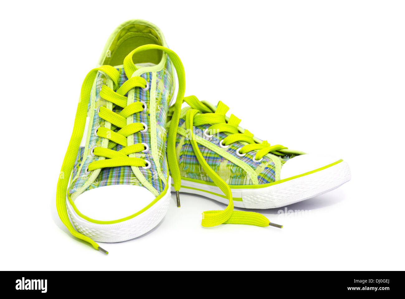 bdd91980492118 Closeup of yellow sneakers with shoelaces isolated on white background