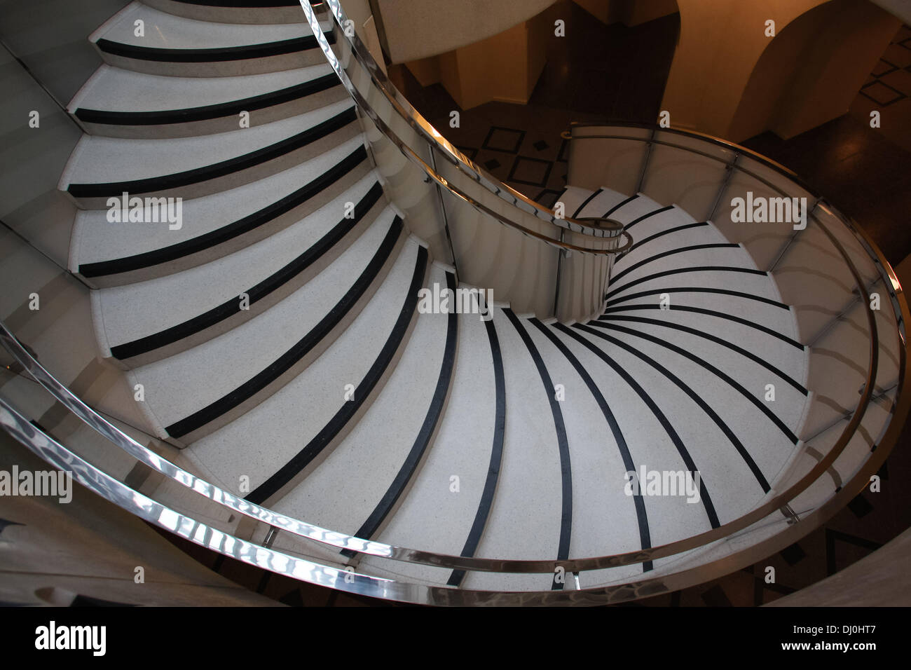 London, UK. 18th November 2013. The striking new spiral staircase sweeping down from the main entrance area to the Stock Photo