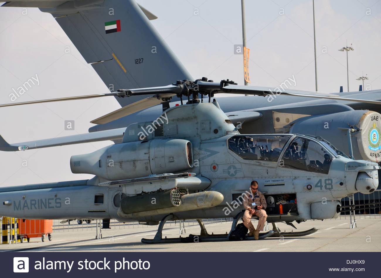 U.S. Marine Corps Capt. James Kerrigan takes a break from the desert sun at the biennial Dubai Airshow at Dubai World Central ai - Stock Image