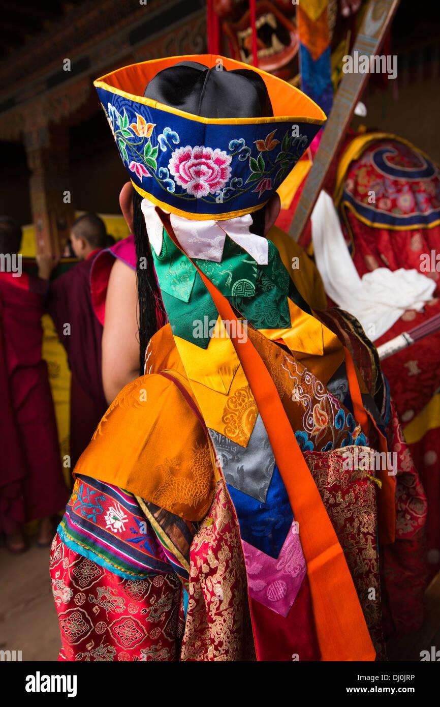 Bhutan, Thimpu Dzong, annual Tsechu, monk musician in colourful embroidered costume - Stock Image