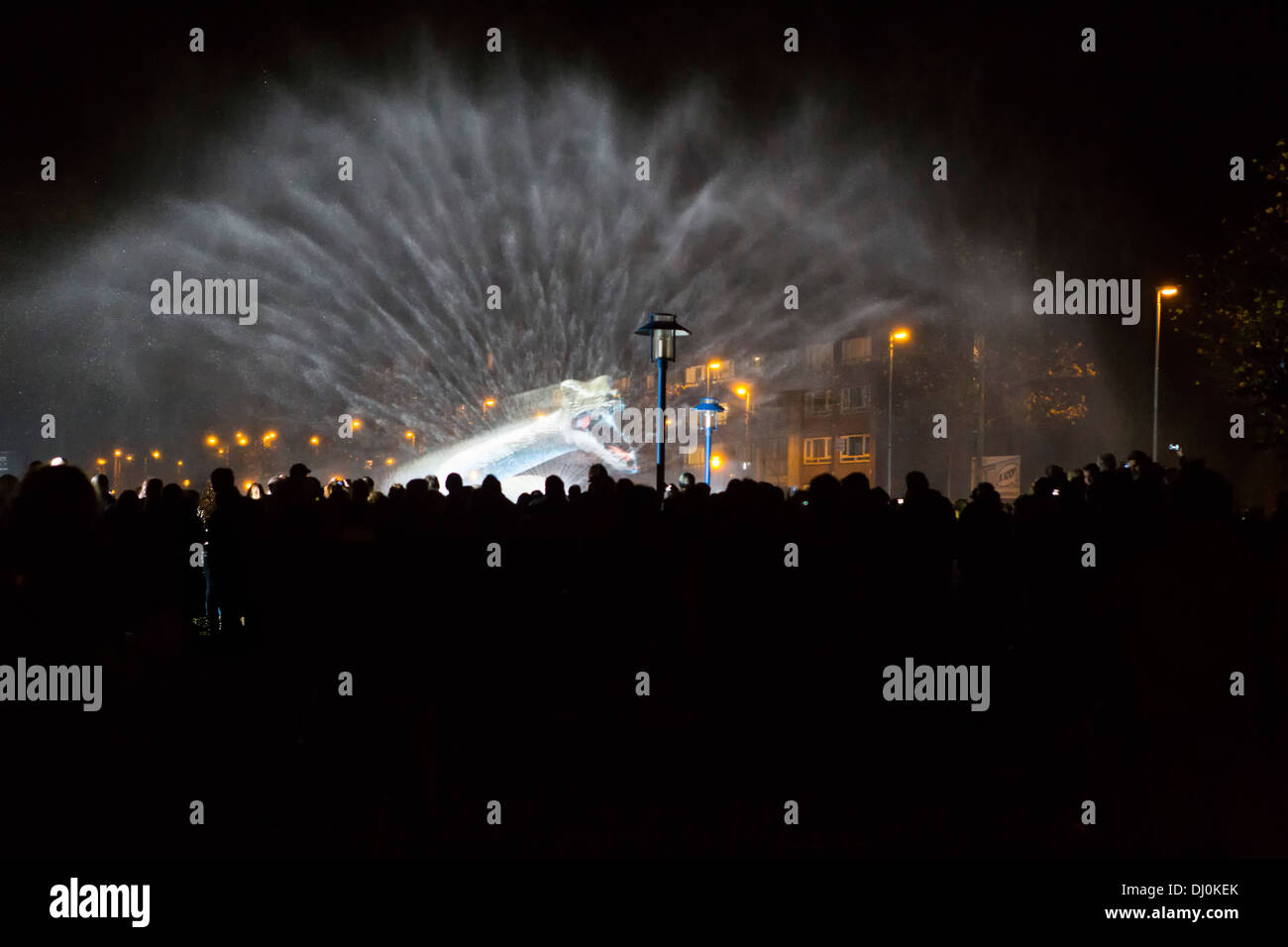 Monster attack with huge splash of water at audience with smart phones and cell phones at Glow light festival in Eindhoven - Stock Image