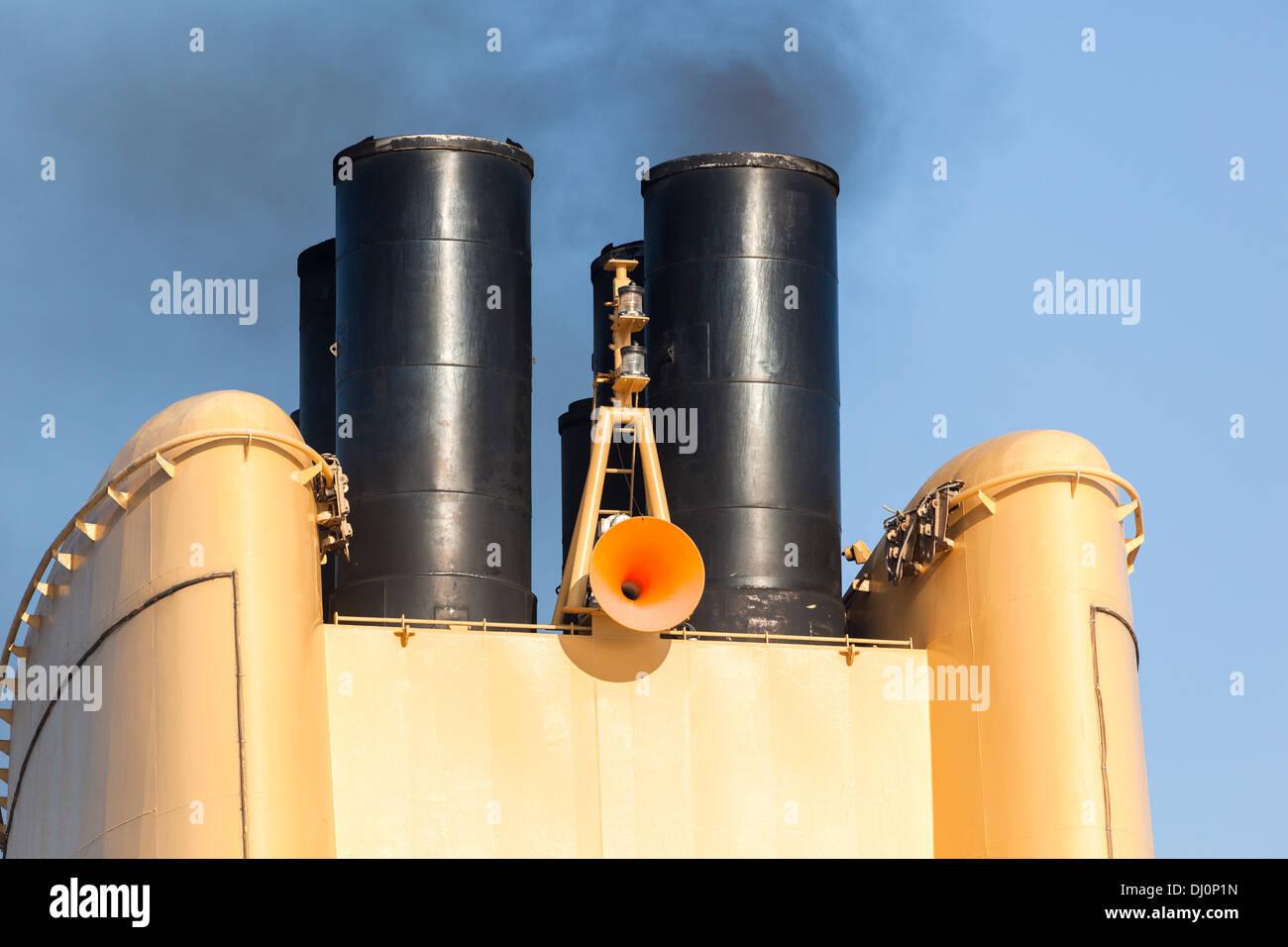 Ship discharging black smoke Stock Photo