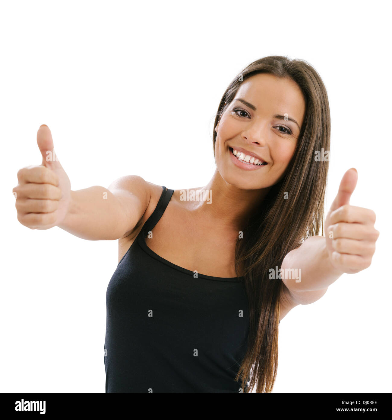 Photo of an excited young female doing the two thumbs up gesture over white background. - Stock Image