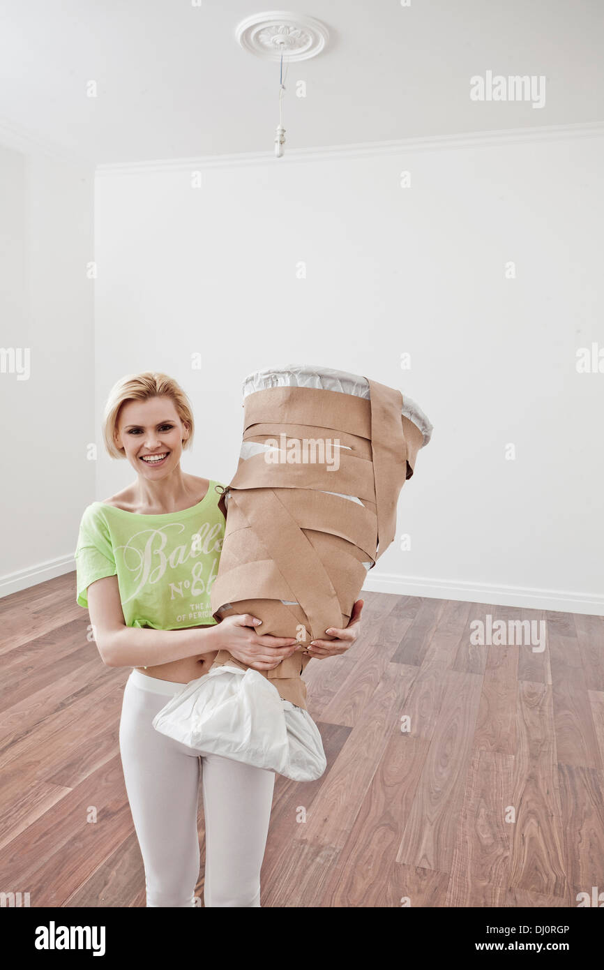 woman moves into a new apartment - Stock Image