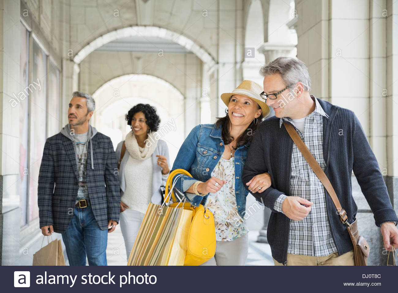 Couples spending time shopping together - Stock Image