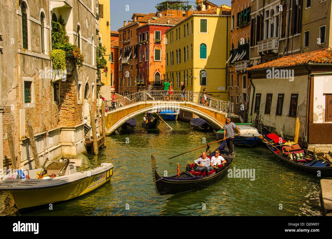 Enjoying a gondola ride in Venice, Italy. Stock Photo