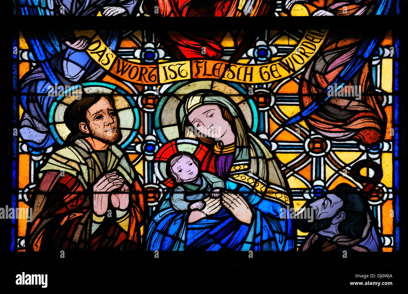 Stained Glass Window at the Town Church, Elsdorf in North West Germany. It shows Mary, Joseph and the baby Jesus. Stock Photo