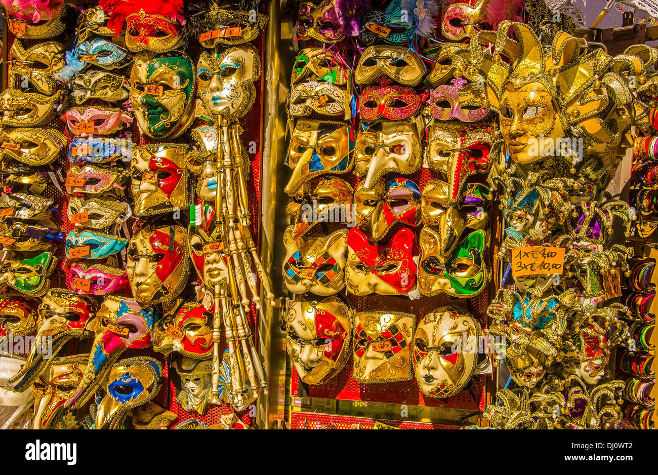 Carnival masks are very popular tourist souvenirs and are displayed in many small shops and street stalls. - Stock Image