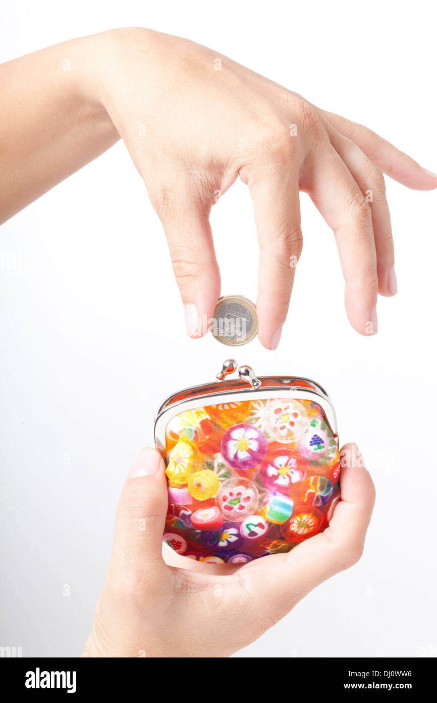 woman's hand with coin and purses - Stock Image