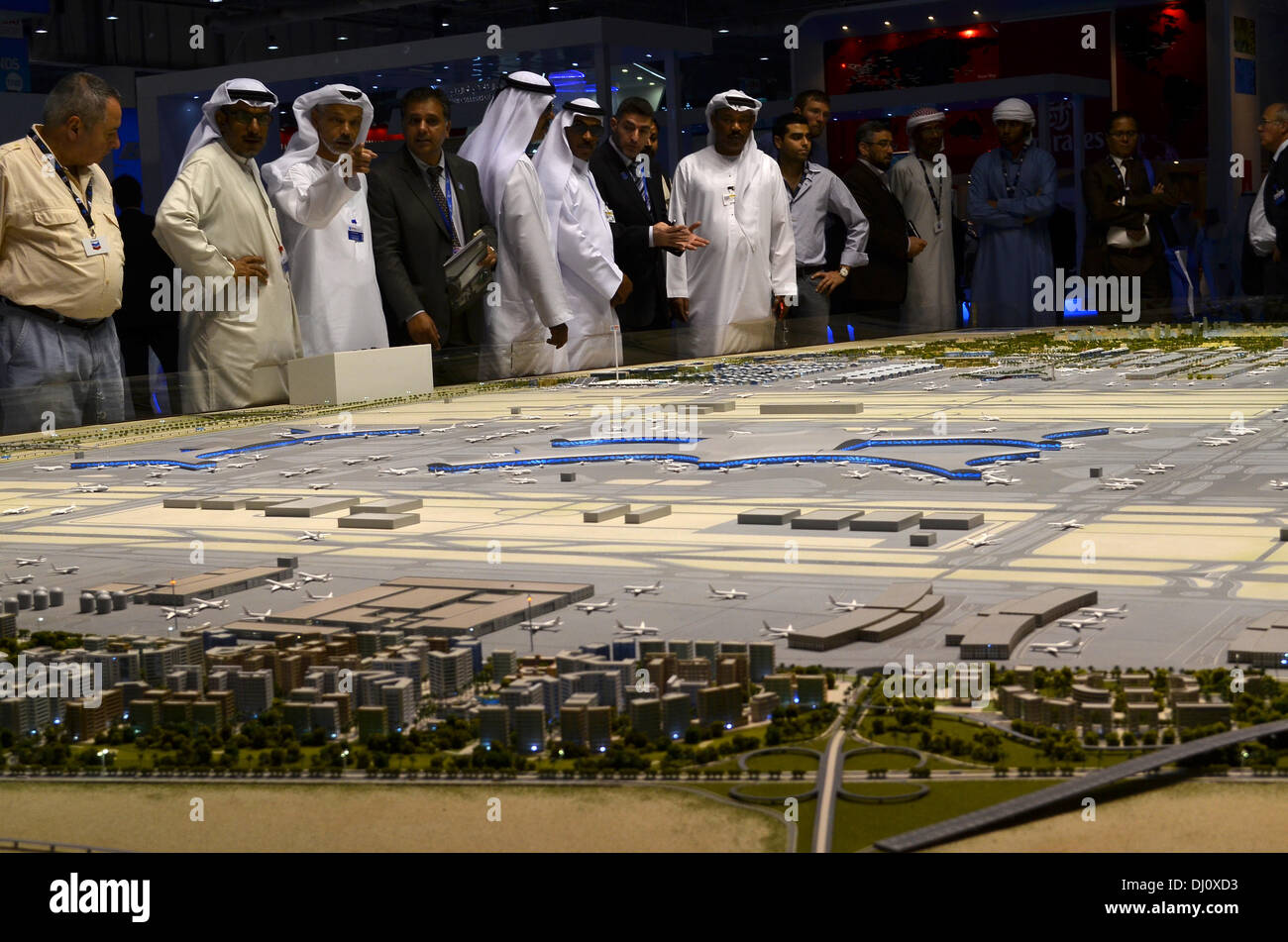 Dubai. 18th November 2013: Springing out of the desert - visitors to the 2013 Dubai Air Show take a look at a scale - Stock Image