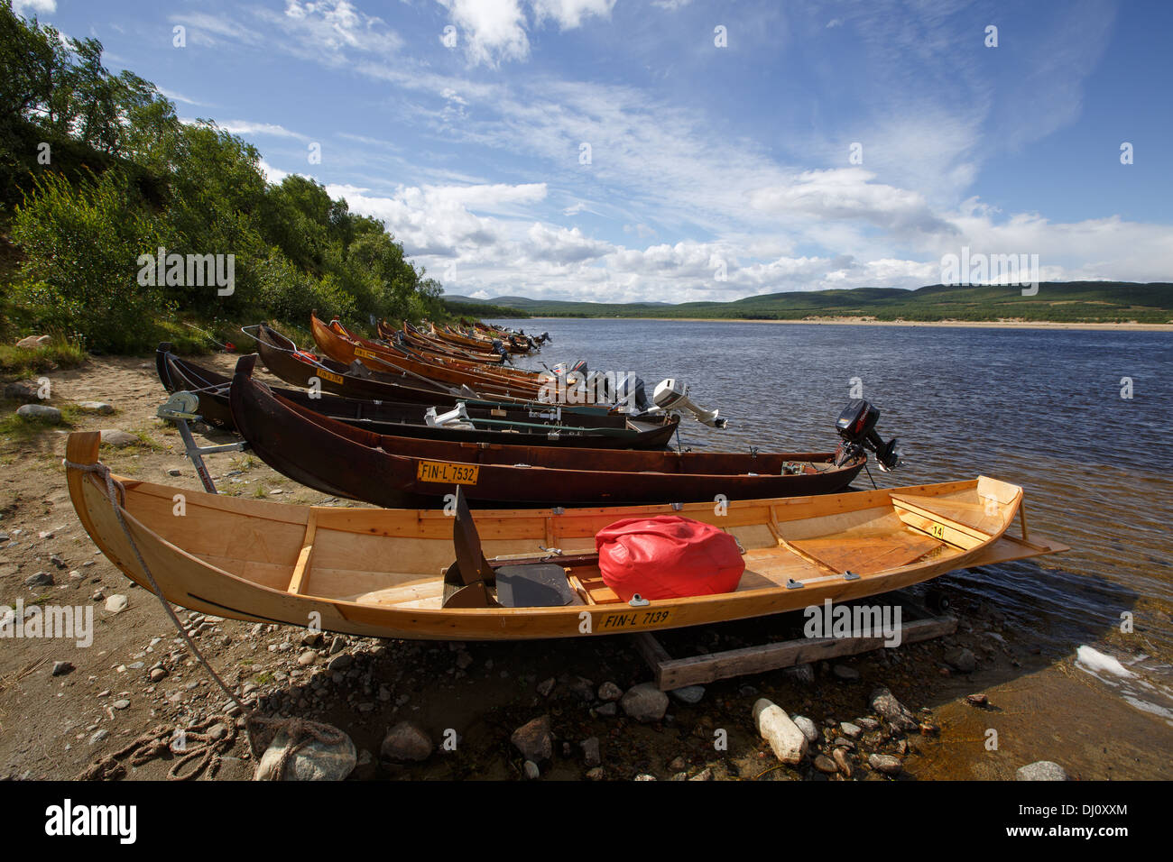 Wooden boats with outboard motors for salmon fishing on river Teno, the natural border between Norway and Finland in Lapland. - Stock Image