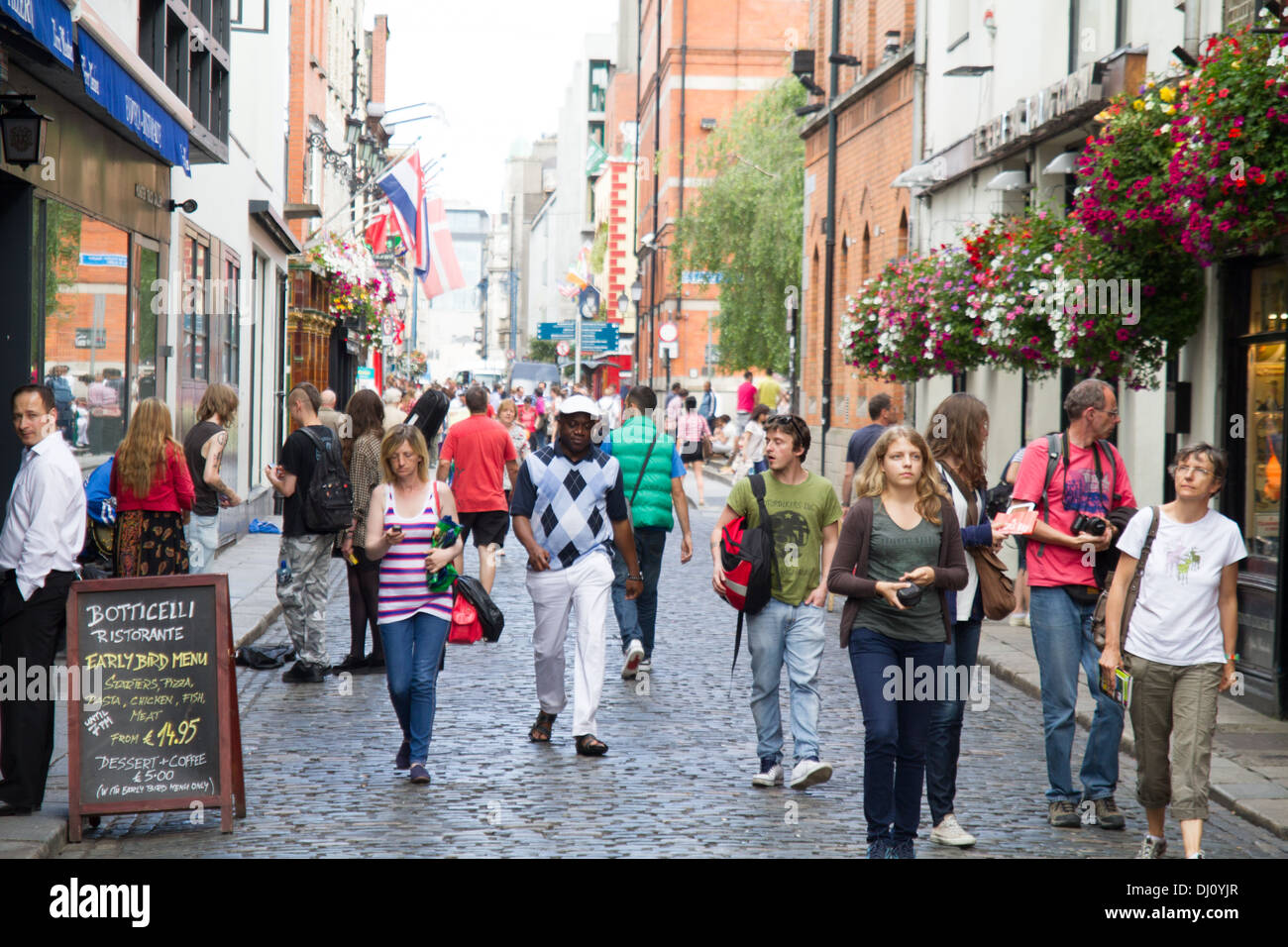 Busy street in Temple Bar district Dublin Ireland - Stock Image