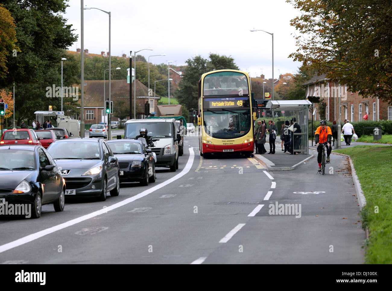 Bus lane and separate cycle lane,  Lewes Road, Brighton. The bus stop is positioned between the bus lane and cycle lane. - Stock Image